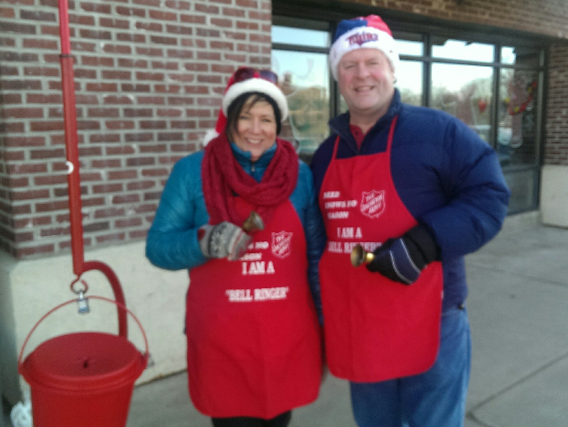 Two NUMC volunteers ringing bells for the Salvation Army outside EconoFoods
